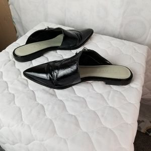 1.State Felid black patent leather mules. S